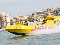 With yellow vests in the jet boat