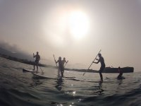 Paddle surf with the sunset