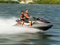 Father and son on a jet ski