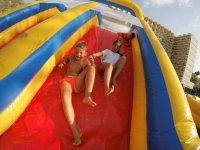 Sliding down the plastic slide