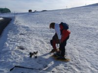 adjusting the snowshoes