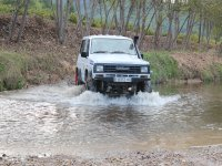 Crossing the river in the off-road vehicle