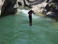 Jumping into the water of the ravine
