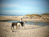 Enjoying the beach on a horse in Galicia