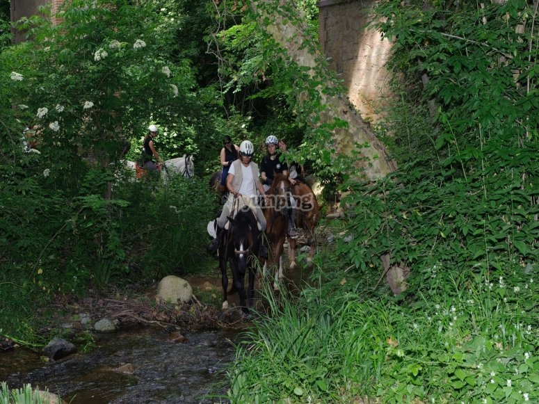 Passing a river with our horses