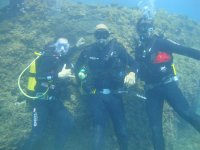 Three scuba divers under water