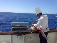 Preparing a barbecue on board