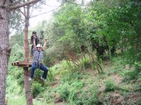 Holding on to the zip line in Montnegre