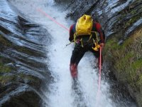 rappelling the waterfall