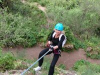 Rappelling over the forest in Malaga