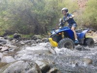 Crossing the river stones with the quad