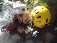 Happy under the stream of the ravine