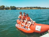 The kids on board the inflatable banana