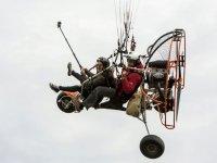 Flying a paramotor holding a camera