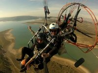 Powered paraglider over the reservoir