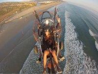 Paramotor trike over the beach