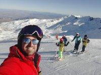 Profe con sus alumnos de esqui