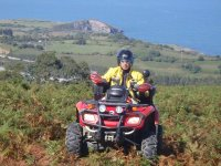 By quad with the sea in the background