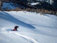 Descenso con tabla de snowboard