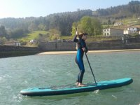 Girl on sup board with the breeze