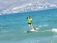 Girl with sup board and yellow shirt