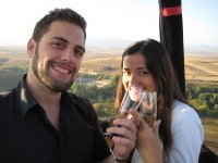 A couple toasting on the balloon