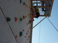 Reaching the top of the climbing wall