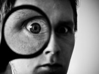 Magnifying glass with eye