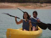 Couple in canoe paddling