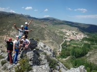 Climbers waving from the top