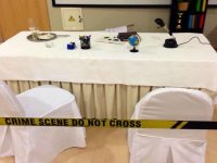Examines the crime scene