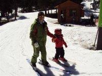 ski teacher with child