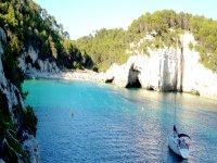 Image sea blue sailboat cliff