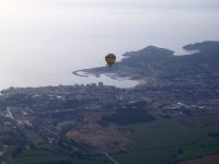 A balloon over the Costa Brava and buildings