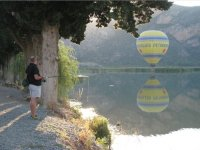 Fishing with a balloon in the background