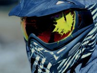Paintball mask marked by paint