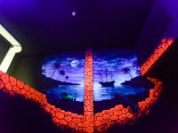 Murals that glow in the dark of laser tag