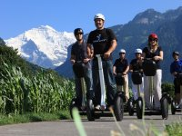 On segway with snow in the background