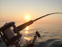 Pescando con el sol poniendose