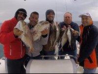 Mostrando orgullosos la pesca