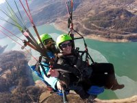 Making paragliding over the river