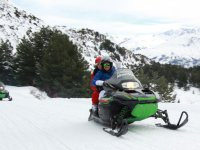 Riding the two-seater snowmobile