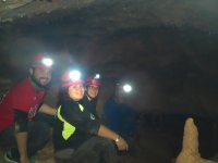 Inside the cave with the lights of the hulls