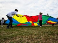 Shaking the colored parachutes