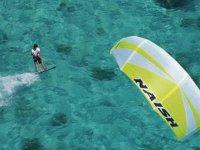 Practicing Kitesurf in crystal clear waters