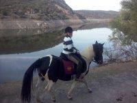 On horseback along the riverbank