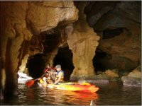 Exploring the caves with the kayak
