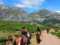 On horseback between the mountains