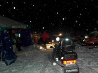 Returning at night with a snowmobile