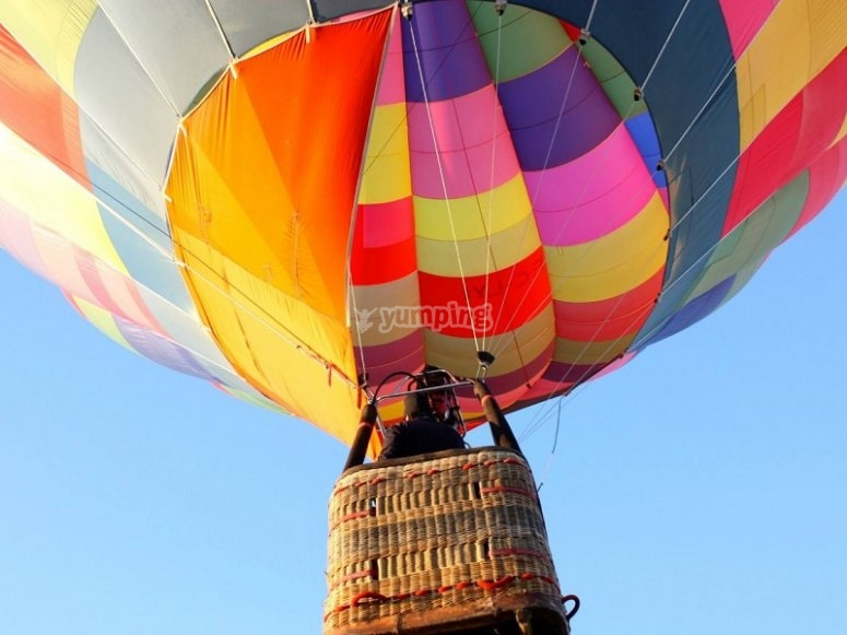 Taking off on the colorful aerostatic balloon